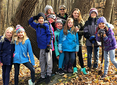 Leaders with kids on nature walk